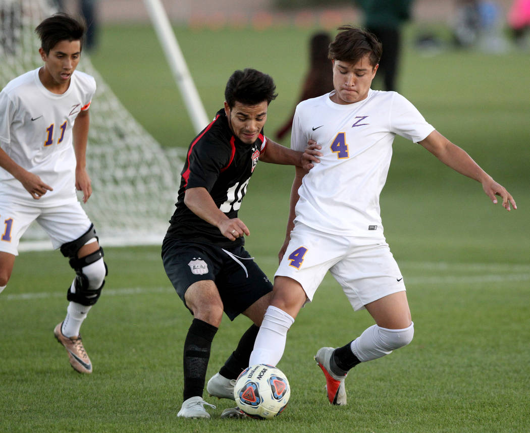 Las Vegas' Fernando Gomez (10) and Durango's Gael Delangel-Parra (4) battle for the ball in the first half of their Class 4A state boys soccer semifinal game at Bettye Wilson Soccer Complex in Las ...