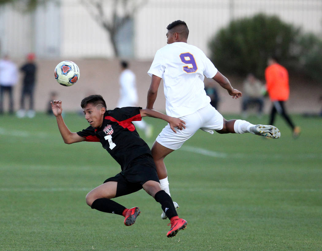 Las Vegas' Luis Hernandez (7) and Durango's Jose Alcocer (9) battle for the ball in the first half of their Class 4A state boys soccer semifinal game at Bettye Wilson Soccer Complex in Las Vegas F ...