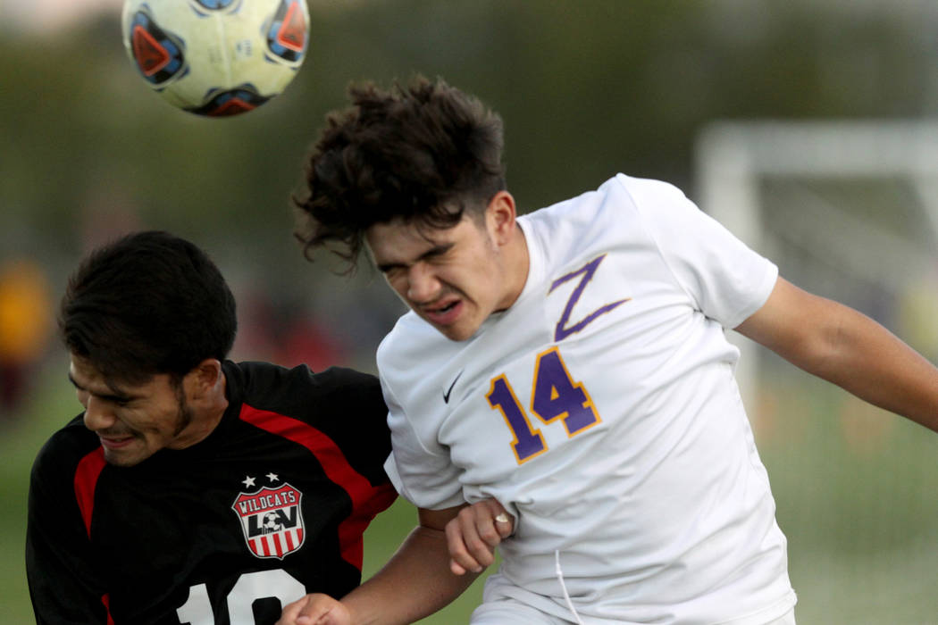 Las Vegas' Fernando Gomez (10) and Durango's Cristian DeLeon-Morales (14) battle for the ball in the first half of their Class 4A state boys soccer semifinal game at Bettye Wilson Soccer Complex i ...