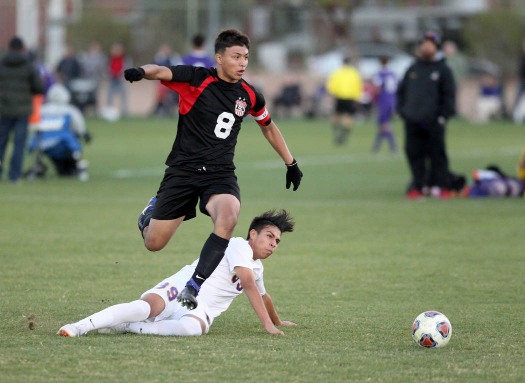 Las Vegas' Daniel Rangel (8) and Durango's Adonis Rodriguez (39) battle for the ball in the first half of their Class 4A state boys soccer semifinal game at Bettye Wilson Soccer Complex in Las Veg ...