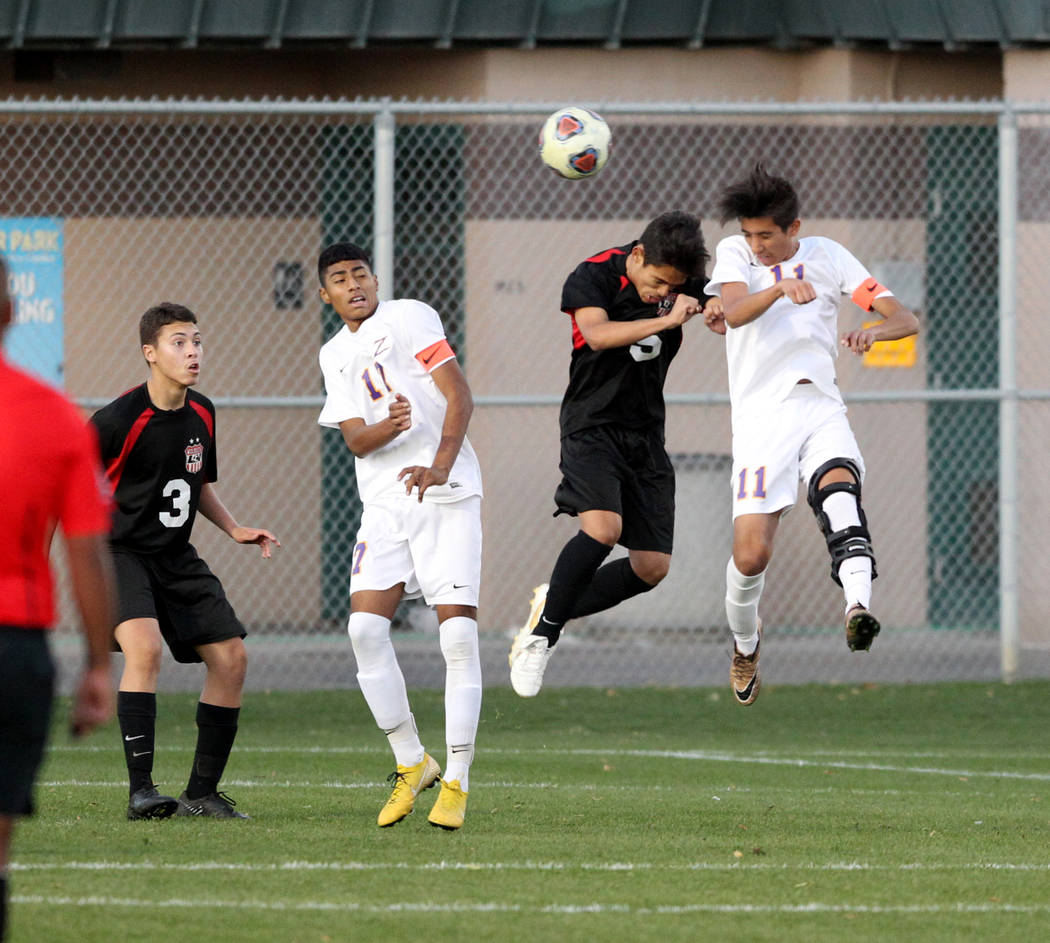Las Vegas' Sebastian Contreras (5) and Durango's Christopher Bramasco (11) battle for the ball as Las Vegas' Carlos Sanchez (3) and Durango's Marcos Delgado (17) look on in the first half of their ...