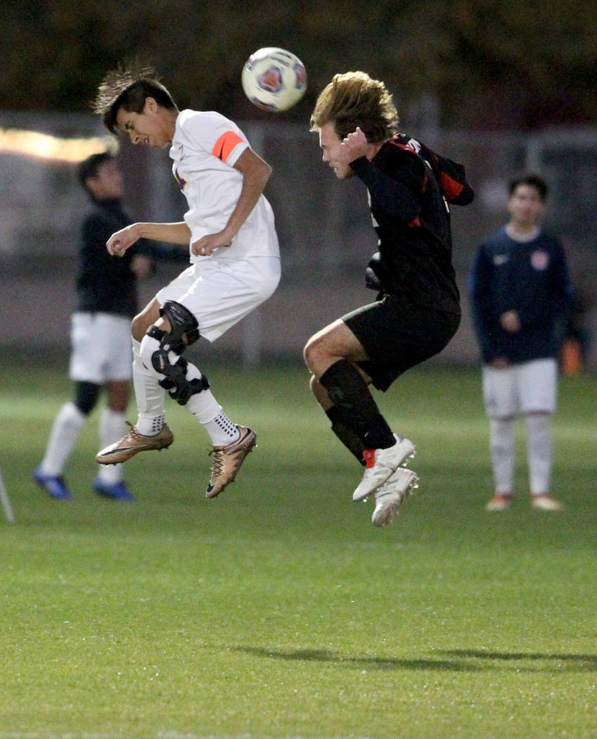 Durango's Christopher Bramasco (11), left, and Las Vegas' Drew Bowden (2) battle for the ball in the second half of their Class 4A state boys soccer semifinal game at Bettye Wilson Soccer Complex ...