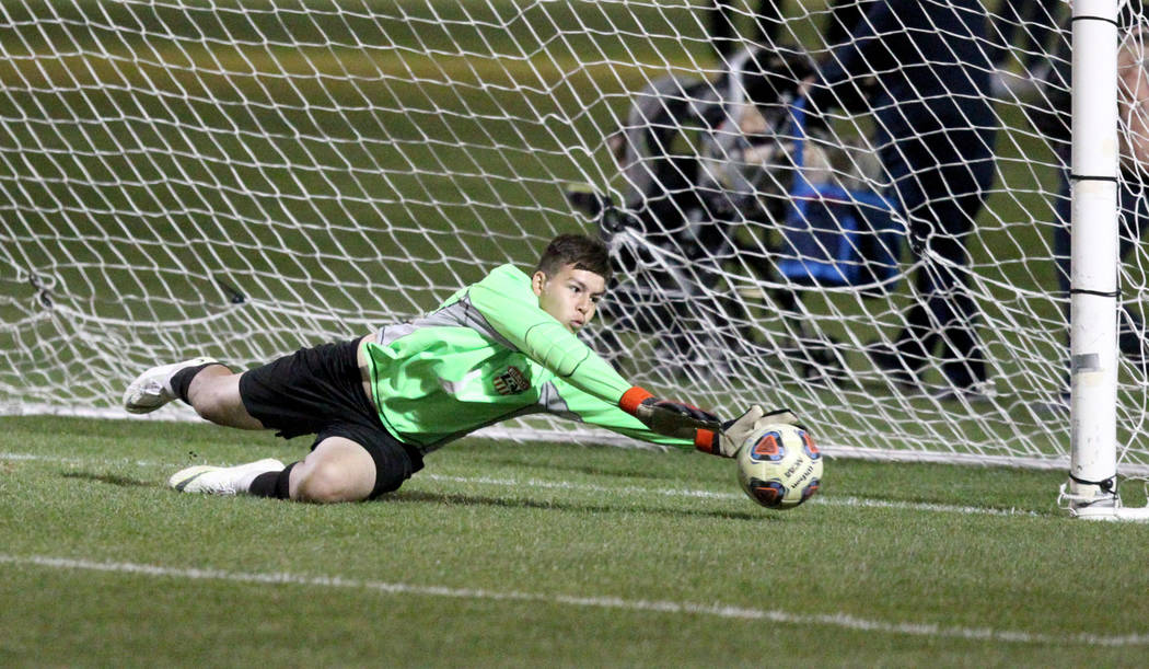 Las Vegas goalie Las Vegas' Rodolfo Gomez (1) makes a save in the second half of their Class 4A state boys soccer semifinal game at Bettye Wilson Soccer Complex in Las Vegas Friday, Nov. 9, 2018. ...