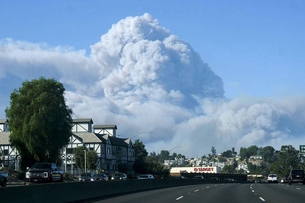 A large plum of smoke from a brush fire rises over Santa Monica Mountains is seen from 101 freeway in Woodland Hill, Calif., Friday, Nov. 9, 2018. (AP Photo/Ringo H.W. Chiu)