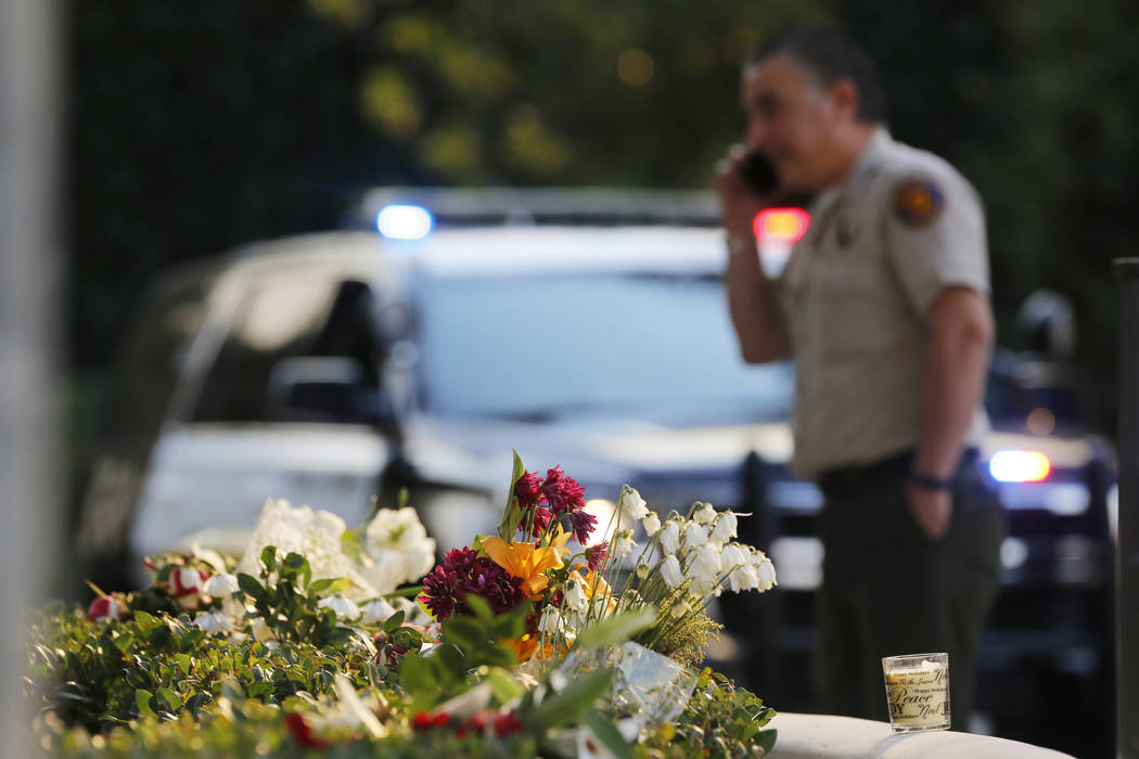 A bouquet of flowers, left by mourners, lays near the site of Wednesday's mass shooting, in Thousand Oaks, Calif., Friday, Nov. 9, 2018. Investigators continue to work to figure out why an ex-Mari ...