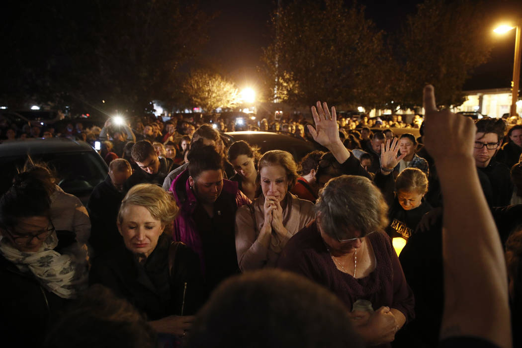 People gather outside the Rivalry Roasters coffee shop for a vigil for Sean Adler Thursday, Nov. 8, 2018, in Simi Valley, Calif. Adler was killed in Wednesday night's shooting at the Borderline Ba ...
