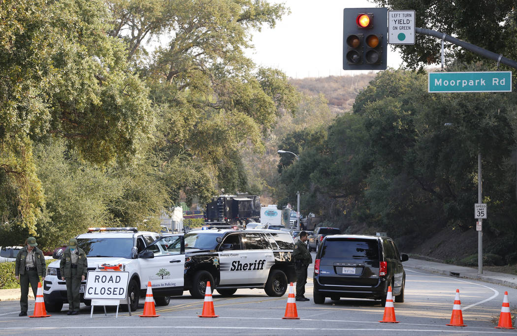 Police block the entrance to the parking lot leading to the Borderline Bar & Grill in Thousand Oaks, Calif., Thursday, Nov. 8, 2018. A gunman opened fire Wednesday evening inside a country mus ...