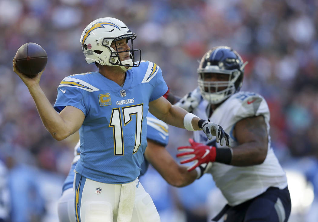 Los Angeles Chargers quarterback Philip Rivers (17) passes the ball during the first half of an NFL football game against Tennessee Titans at Wembley stadium in London, Sunday, Oct. 21, 2018. (AP ...