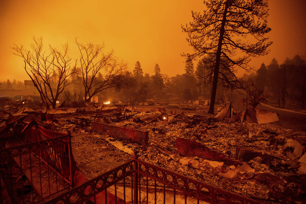 Rubble lines a lot on Skyway after a wildfire burned through Paradise, Calif., on Friday, Nov. 9, 2018. (AP Photo/Noah Berger)