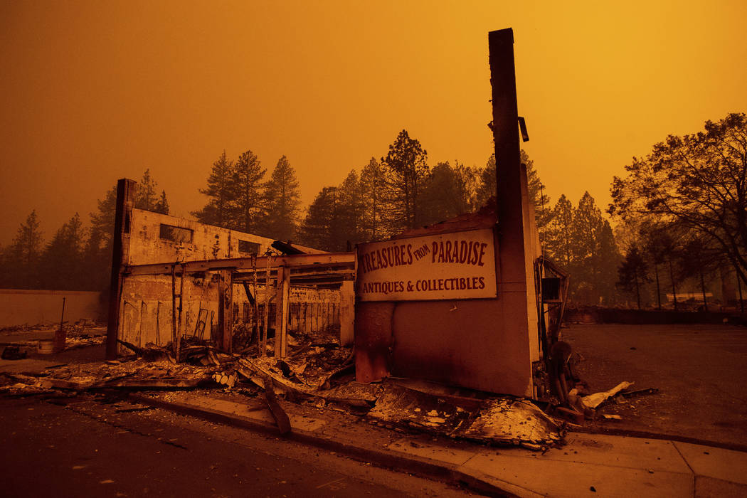 The walls of a scorched antique shop stand on Skyway after a wildfire burned through Paradise, Calif., on Friday, Nov. 9, 2018. (AP Photo/Noah Berger)