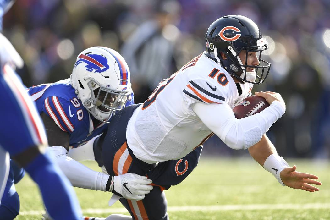 Buffalo Bills' Shaq Lawson (90) tackles Chicago Bears' Mitchell Trubisky (10) near the end zone during the first half of an NFL football game Sunday, Nov. 4, 2018, in Orchard Park, N.Y. (AP Photo/ ...