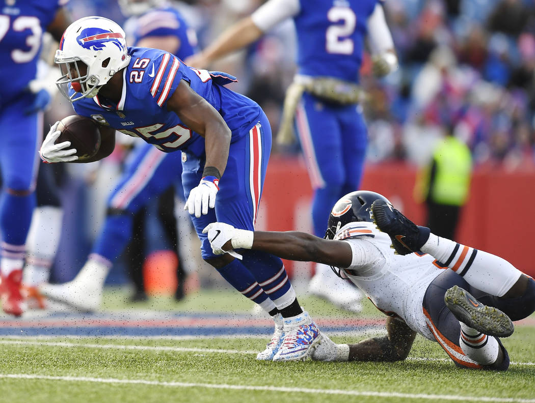 Buffalo Bills running back LeSean McCoy (25) is tackled by Chicago Bears' Roquan Smith (58) during the second half of an NFL football game Sunday, Nov. 4, 2018, in Orchard Park, N.Y. (AP Photo/Adr ...