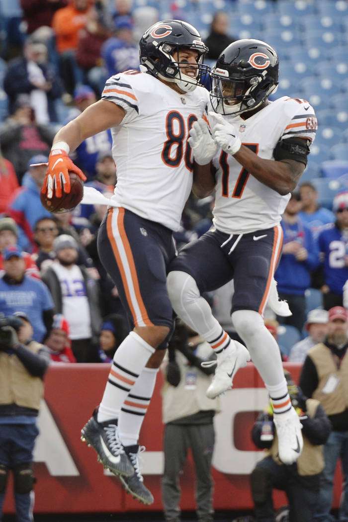 Chicago Bears tight end Trey Burton (80) celebrates with Anthony Miller (17) after catching a pass for a touchdown during the second half of an NFL football game against the Buffalo Bills Sunday, ...