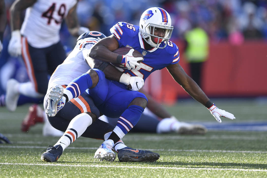 FILE - In this Sunday, Nov. 4, 2018, file photo, Buffalo Bills running back LeSean McCoy (25) is tackled during the second half of an NFL football game against the Chicago Bears in Orchard Park, N ...