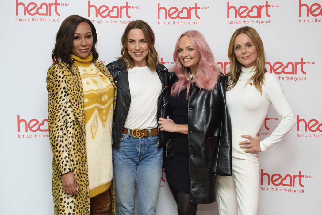 In this Wednesday, Nov. 7, 2018 file photo, Spice Girls from left, Melanie Brown, Melanie Chisholm, Emma Bunton and Geri Horner pose for a photo during a live appearance on a radio show at Global ...