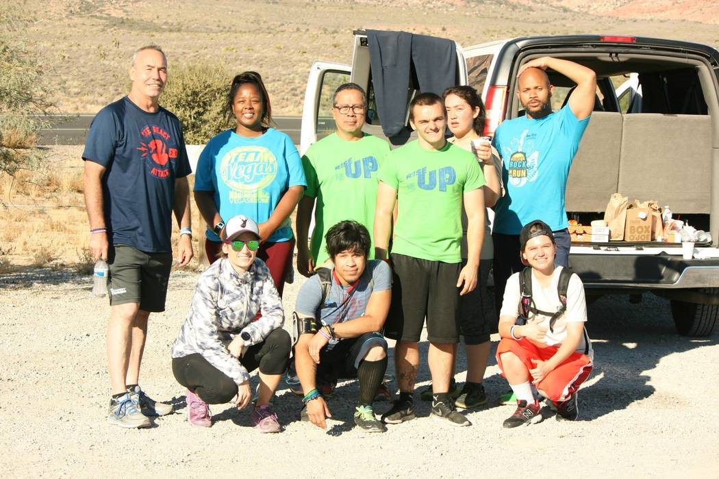 The Up and Running Again group poses at Red Rock on Oct. 20. Photo by Jose Santos