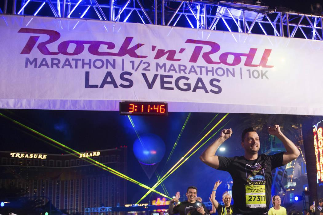 Participants cross the finish line during the Rock 'n' Roll Las Vegas Marathon Sunday, November 12, 2017, in Las Vegas. CREDIT: Sam Morris/Las Vegas News Bureau