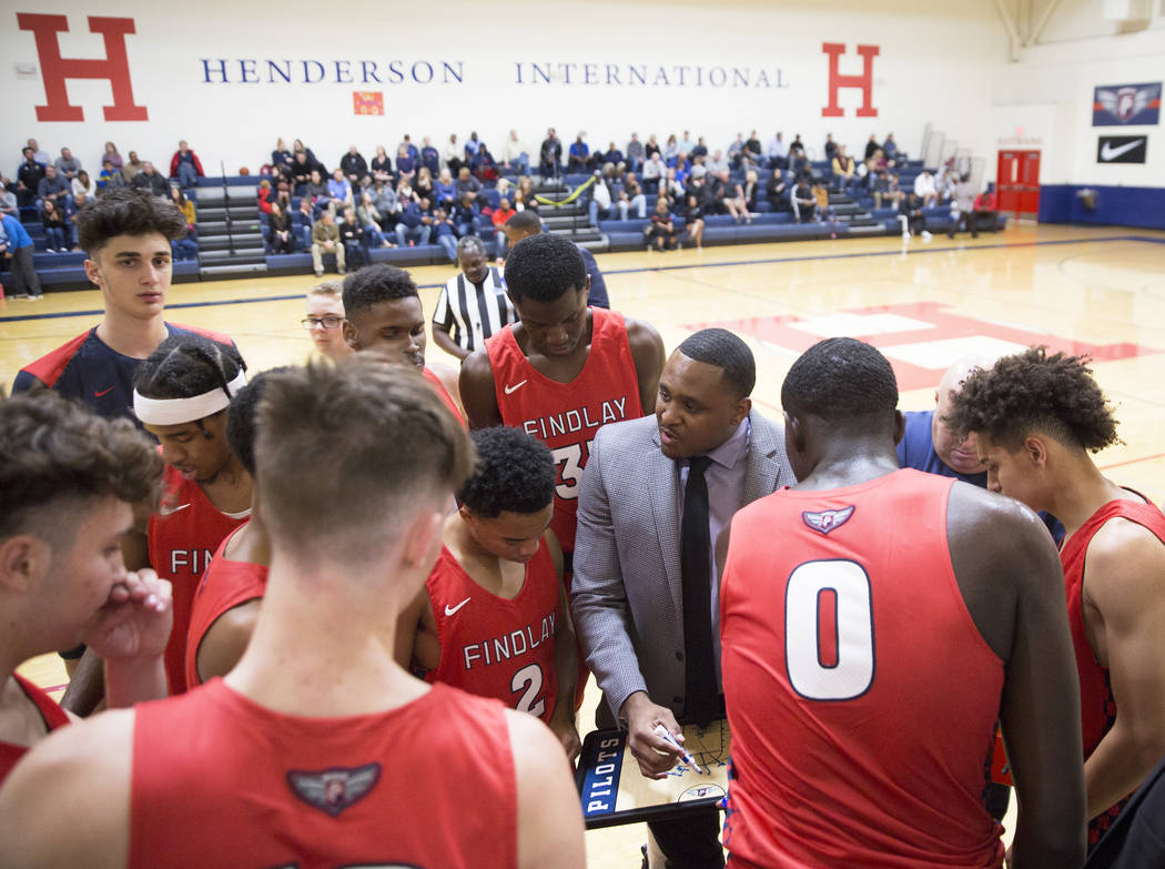 Findlay Prep head coach Rodney Haddix, right, draws up a play during a timeout during the Pilot's home matchup with Bella Vista College Prep on Friday, November 9, 2018, in Henderson. Benjamin Hag ...