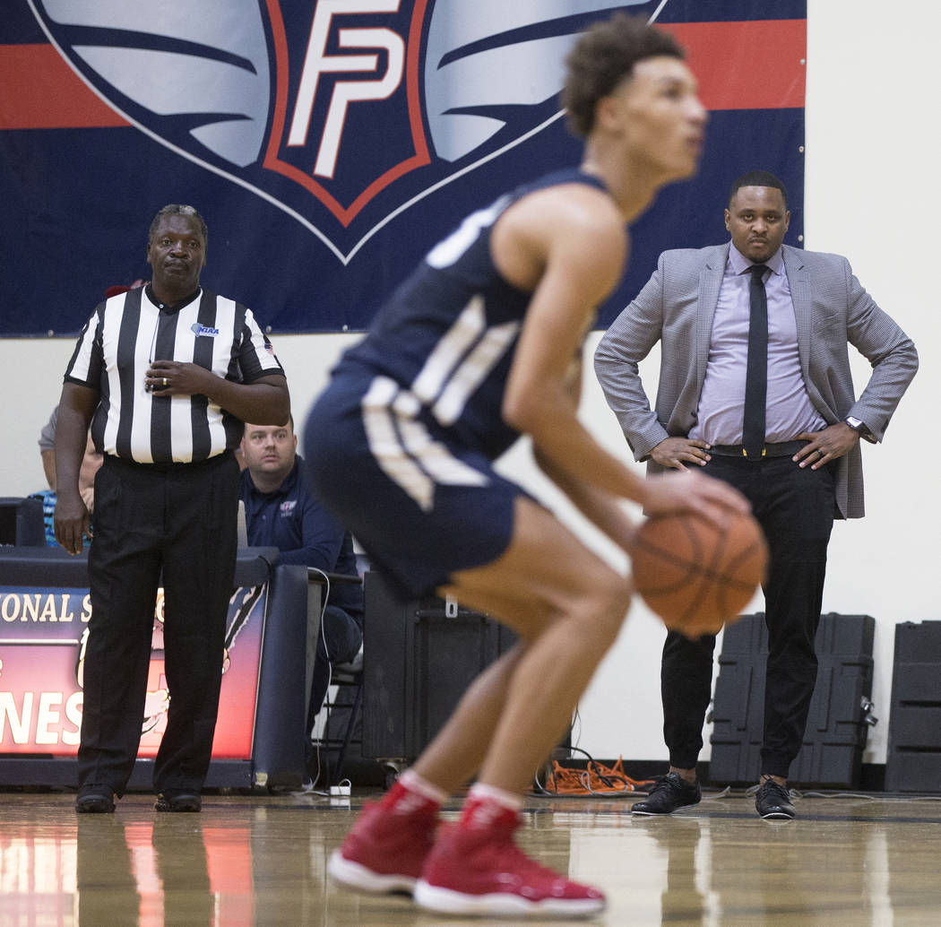 Findlay Prep head coach Rodney Haddix, right, watches a Bella Vista College Prep player shoot a free throw on Friday, November 9, 2018, in Henderson. Benjamin Hager Las Vegas Review-Journal