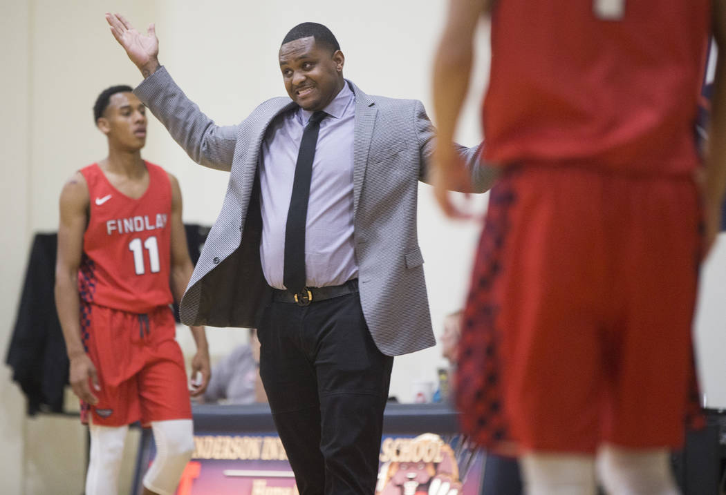 Findlay Prep head coach Rodney Haddix, middle, contests a call during the Pilot's home matchup with Bella Vista College Prep on Friday, November 9, 2018, in Henderson. Benjamin Hager Las Vegas Rev ...