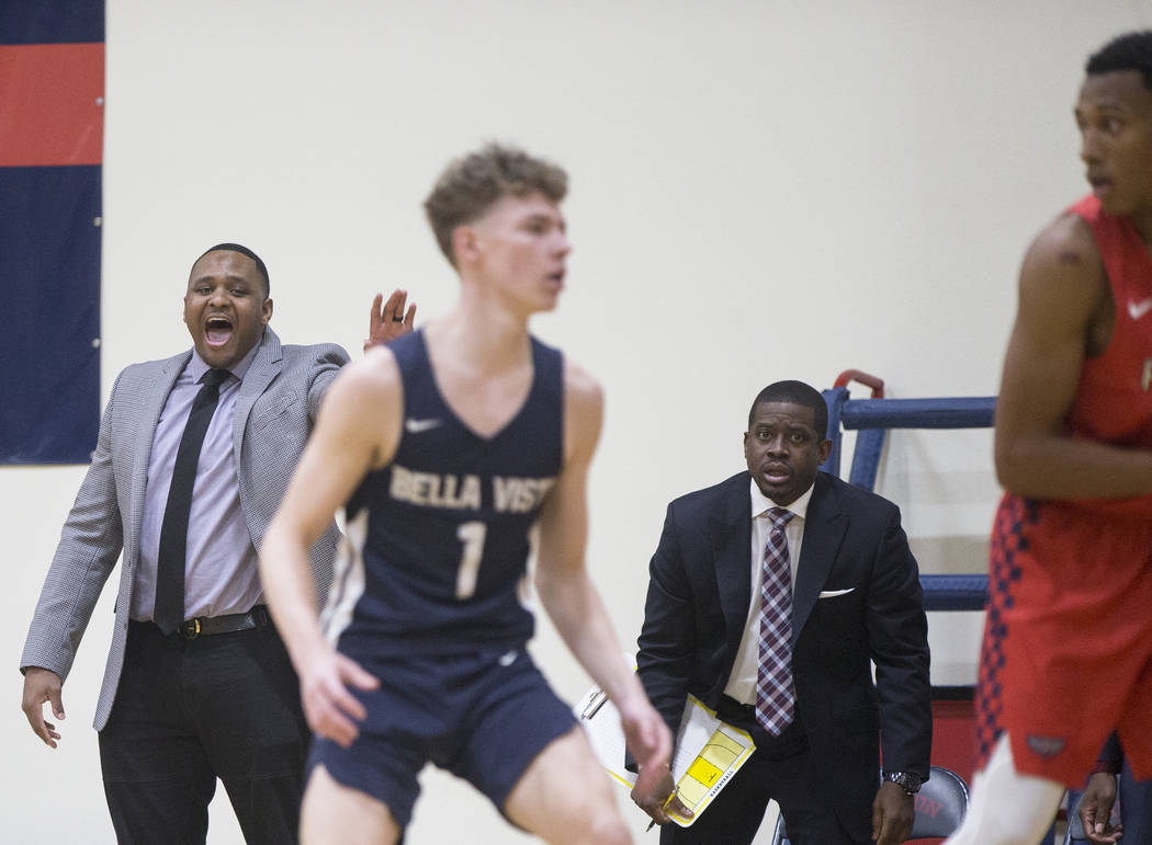 Findlay Prep head coach Rodney Haddix, left, makes a call during the Pilot's home matchup with Bella Vista College Prep on Friday, November 9, 2018, in Henderson. Benjamin Hager Las Vegas Review-J ...
