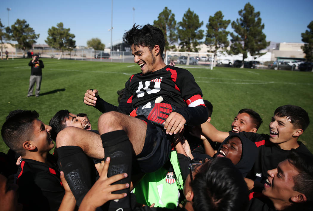 Las Vegas' Fernando Gomez (10) is lifted up by his team after their win against Coronado in the 4A boys state soccer championship game at the Bettye Wilson Soccer Complex in Las Vegas, Saturday, N ...