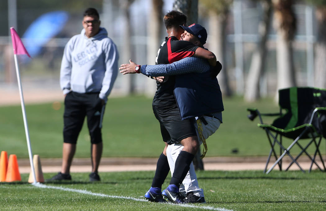 Las Vegas' Daniel Rangel (8) celebrates his goal with his brother Salvador Valencia during the second half against Coronado in the 4A boys state soccer championship game at the Bettye Wilson Socce ...
