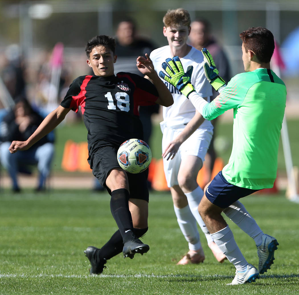 Las Vegas' Sergio Aguayo (18) goes for the ball during the second half against Coronado in the 4A boys state soccer championship game at the Bettye Wilson Soccer Complex in Las Vegas, Saturday, No ...