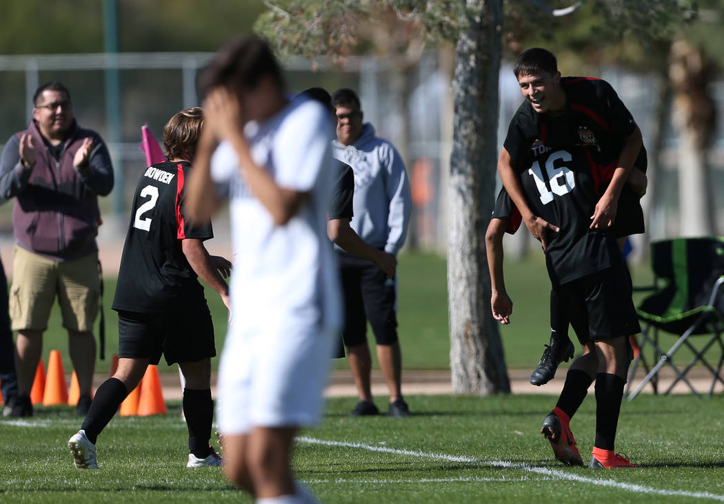 Las Vegas' Sergio Aguayo (18) is lifted up by Nathan Zamora (16) in celebration after his goal during the second half against Coronado in the 4A boys state soccer championship game at the Bettye W ...