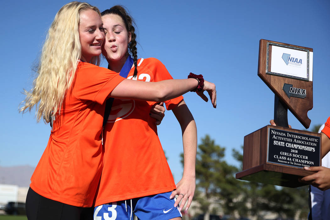 Bishop Gorman's Jacqueline Hillegas (23) and sister Kevyn Hillegas (24) celebrate their 4-0 win against Galena in the 4A girls state soccer championship game at the Bettye Wilson Soccer Complex in ...