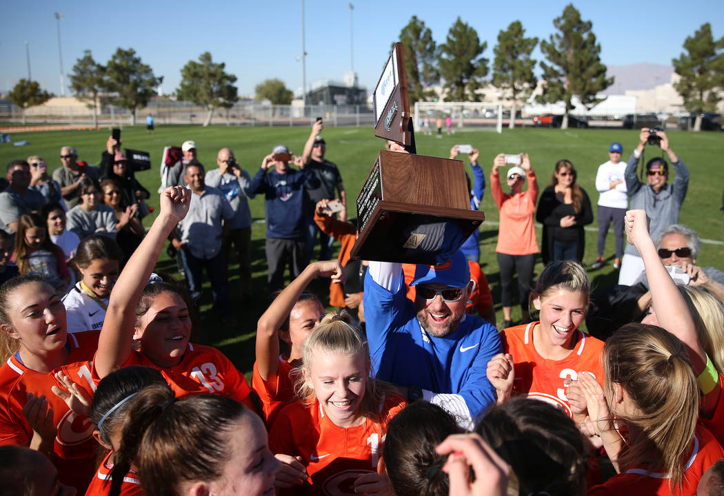 Bishop Gorman raise their trophy in celebration of their 4-0 win against Galena in the 4A girls state soccer championship game at the Bettye Wilson Soccer Complex in Las Vegas, Saturday, Nov. 10, ...