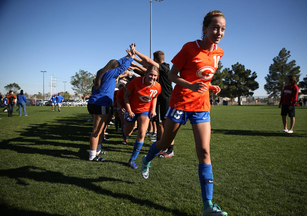 Bishop Gorman's Cambrie Arboreen (72) and Taylor Cox (18) celebrate their 4-0 win against Galena in the 4A girls state soccer championship game at the Bettye Wilson Soccer Complex in Las Vegas, Sa ...