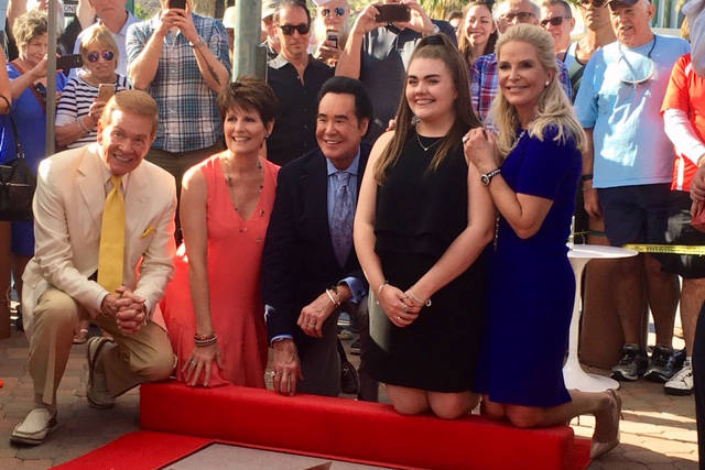 Wink Martindale, Lucie Arnaz, Wayne Newton, Lauren Newton and Kathleen Newton are shown with Wayne Newton's star on the Palm Springs Walk of Stars on Friday, Nov. 9, 2018. (Kevin Sasaki)