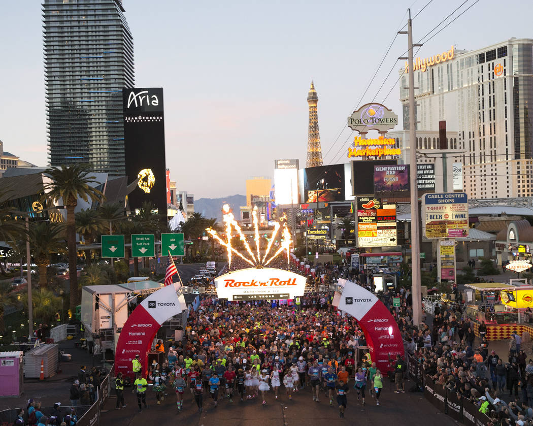 Runners leave the starting line during the 2018 Rock 'n' Roll Marathon on the Strip in Las Vegas on Sunday, Nov. 11, 2018. Richard Brian Las Vegas Review-Journal @vegasphotograph