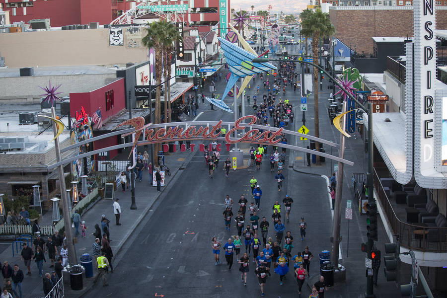 Runners in the 10k race make their way down Fremont Street for the Rock 'n' Roll Marathon in Las Vegas, Sunday, Nov. 11, 2018. Rachel Aston Las Vegas Review-Journal @rookie__rae