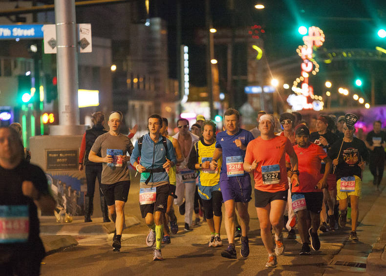 Runners in the marathon and half marathon race make their way down Fremont Street towards Las Vegas Boulevard for the Rock 'n' Roll Marathon in Las Vegas, Sunday, Nov. 11, 2018. Rachel Aston Las V ...