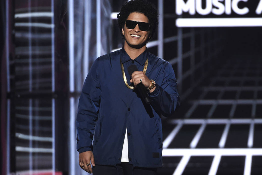 FILE - In this May 20, 2018, file photo, Bruno Mars presents the Icon award at the Billboard Music Awards at the MGM Grand Garden Arena in Las Vegas. (Photo by Chris Pizzello/Invision/AP, File)