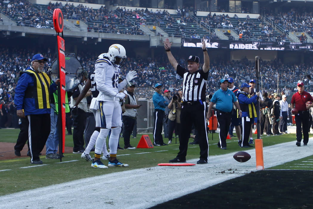 Los Angeles Chargers wide receiver Keenan Allen (13) celebrates his touchdown during the first half of an NFL game against the Oakland Raiders in Oakland, Calif., Sunday, Nov. 11, 2018. Heidi Fang ...