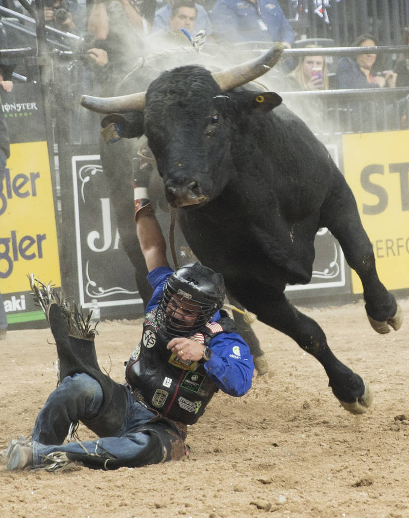 "Rubens Barbosa gets tied up with ""Hanna Motors Two Point Oh"" during the Professional Bull Riders World Finals on Sunday, November 11, 2018, at T-Mobile Arena, in Las Vegas. Benjamin Hage ..."