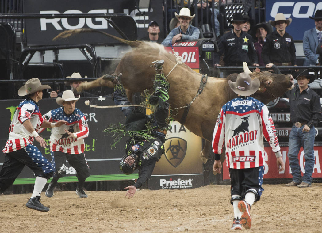 "Jose Vitor Leme gets thrown from ""Frequent Flyer"" during the Professional Bull Riders World Finals on Sunday, November 11, 2018, at T-Mobile Arena, in Las Vegas. Benjamin Hager Las Vegas ..."