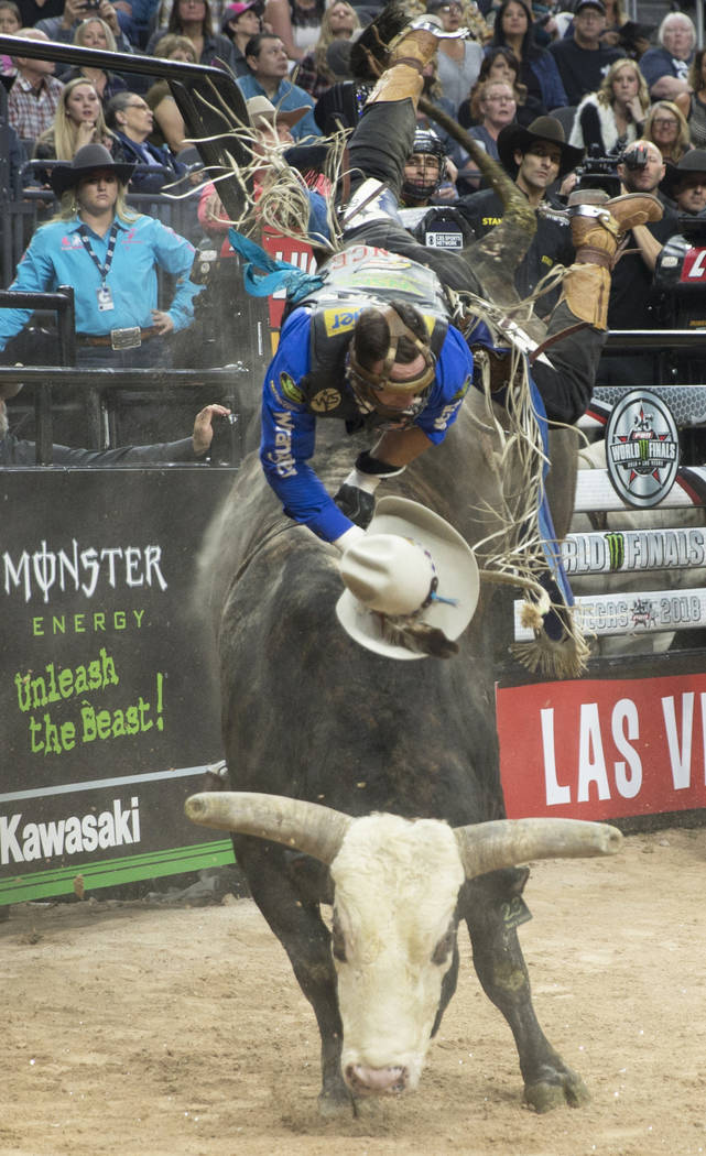 "Cody Nance gets thrown off of ""No Prisoners"" during the Professional Bull Riders World Finals on Sunday, November 11, 2018, at T-Mobile Arena, in Las Vegas. Benjamin Hager Las Vegas Revi ..."