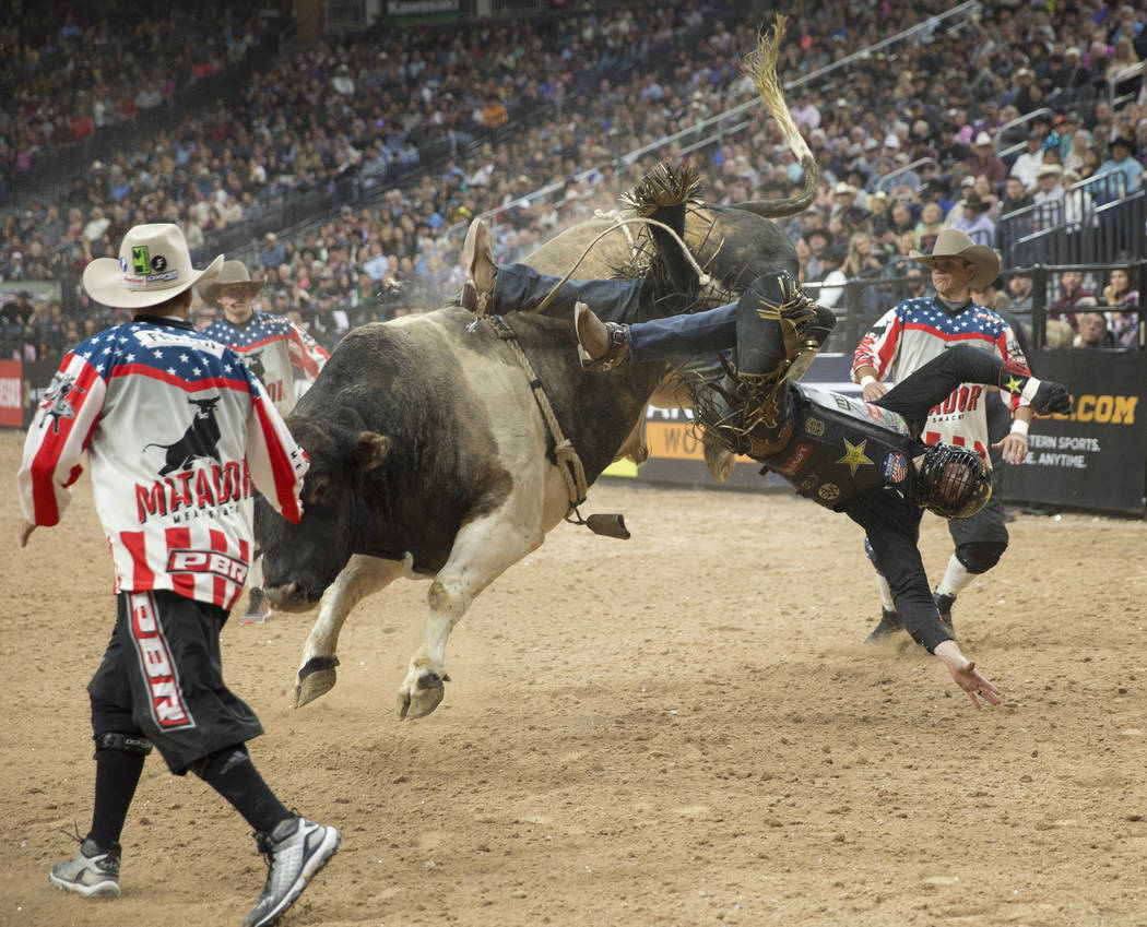 "Cody Teel gets thrown off of ""Bad Beagle"" during the Professional Bull Riders World Finals on Sunday, November 11, 2018, at T-Mobile Arena, in Las Vegas. Benjamin Hager Las Vegas Review- ..."
