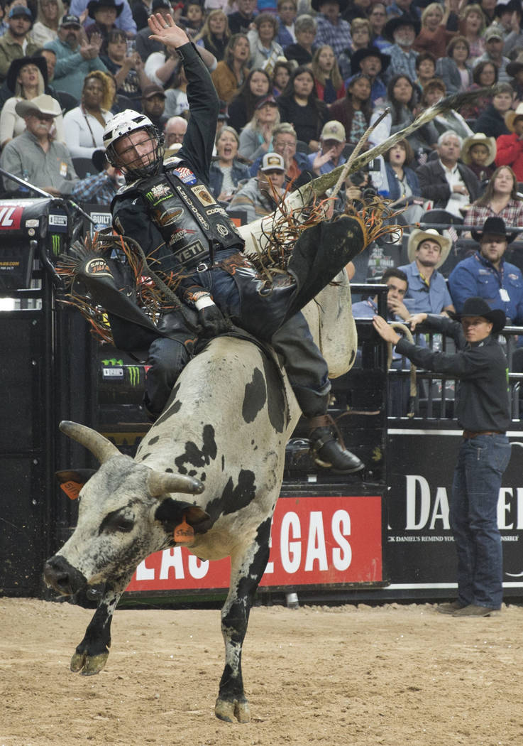 "Cooper Davis rides ""Stretch"" during the Professional Bull Riders World Finals on Sunday, November 11, 2018, at T-Mobile Arena, in Las Vegas. Benjamin Hager Las Vegas Review-Journal"