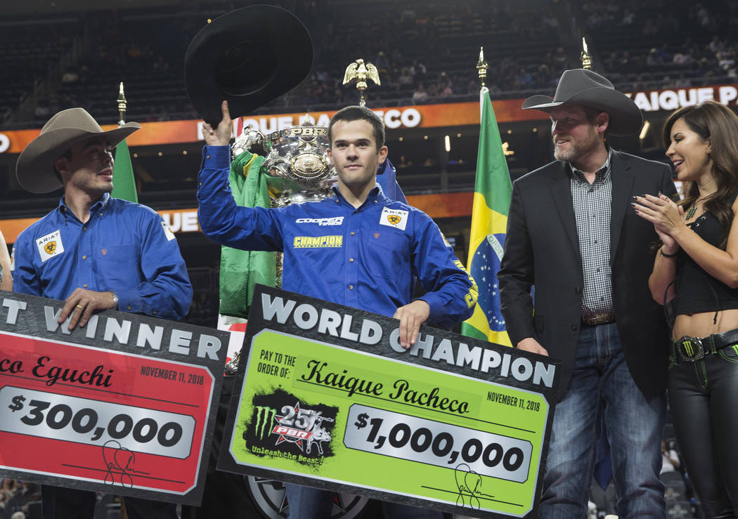 Kaique Pacheco, middle, celebrates after winning the Professional Bull Riders World Championship on Sunday, November 11, 2018, at T-Mobile Arena, in Las Vegas. Benjamin Hager Las Vegas Review-Journal