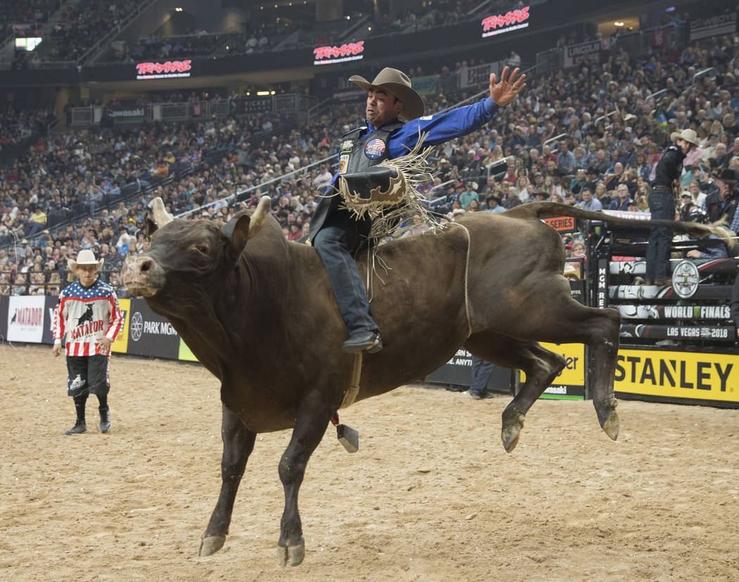 "Marco Eguchi rides ""Lightning Before Thunder"" during the Professional Bull Riders World Finals on Sunday, November 11, 2018, at T-Mobile Arena, in Las Vegas. Benjamin Hager Las Vegas Rev ..."
