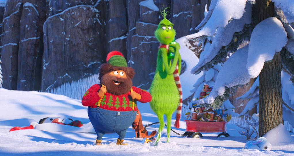 """Bricklebaum, voiced by Kenan Thompson, left, and Grinch, voiced by Benedict Cumberbatch, are seen in a scene from """"The Grinch."""" (Universal Pictures via AP)"""