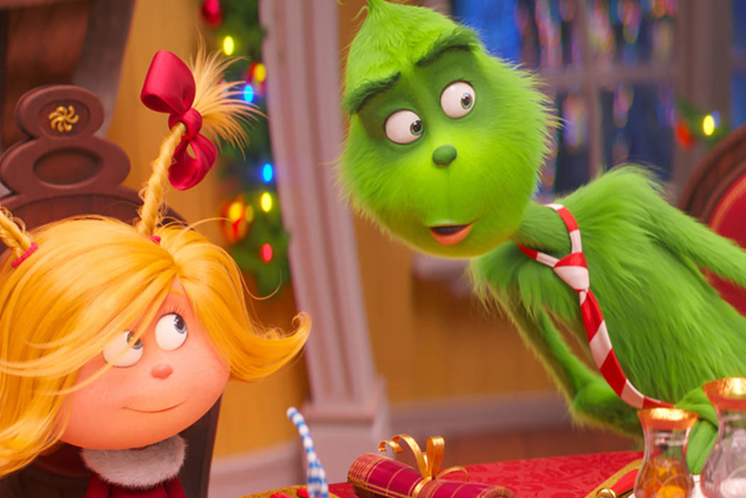 """Cindy-Lou Who, voiced by Cameron Seely, left, and Grinch, voiced by Benedict Cumberbatch, are seen in a scene from """"The Grinch."""" (Universal Pictures via AP, File)"""
