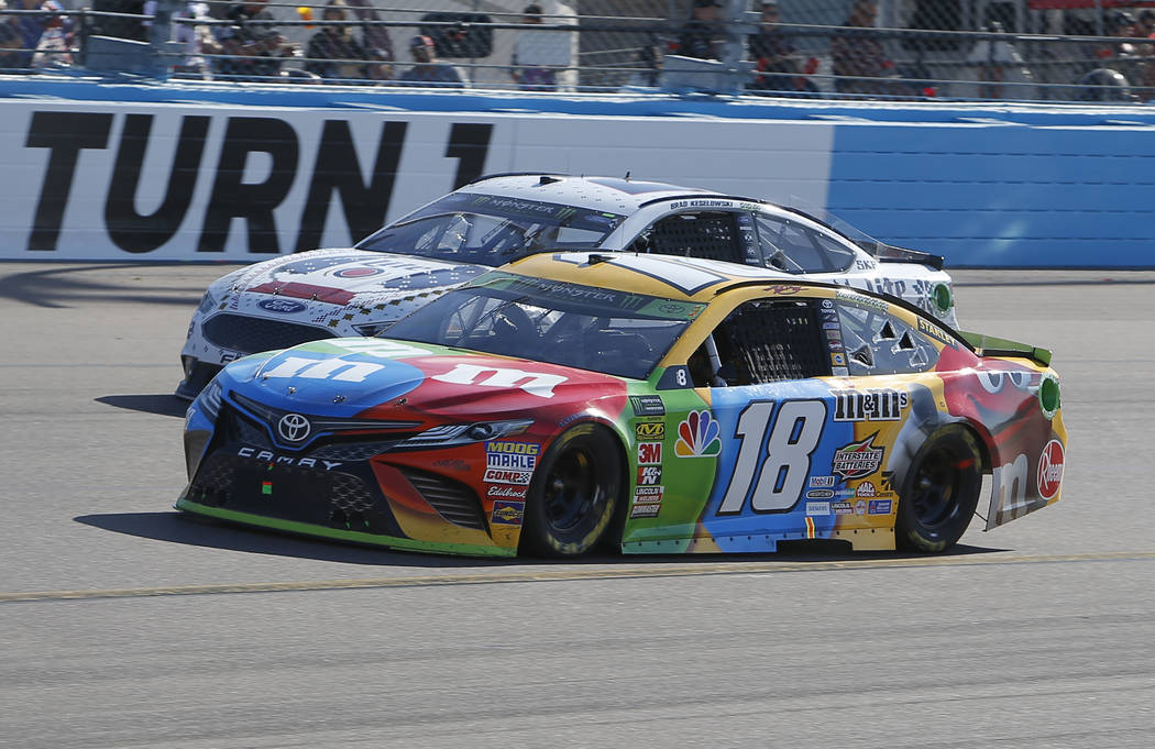 Kyle Busch (18) leads Brad Keselowski (2) on lap 120 during a NASCAR Cup Series auto race on Sunday, Nov. 11, 2018, in Avondale, Ariz. (AP Photo/Rick Scuteri)