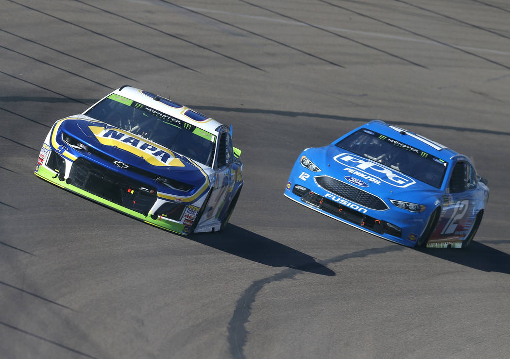 Chase Elliott (9) races with Ryan Blaney on the tenth lap during a NASCAR Cup Series auto race on Sunday, Nov. 11, 2018, in Avondale, Ariz. (AP Photo/Rick Scuteri)