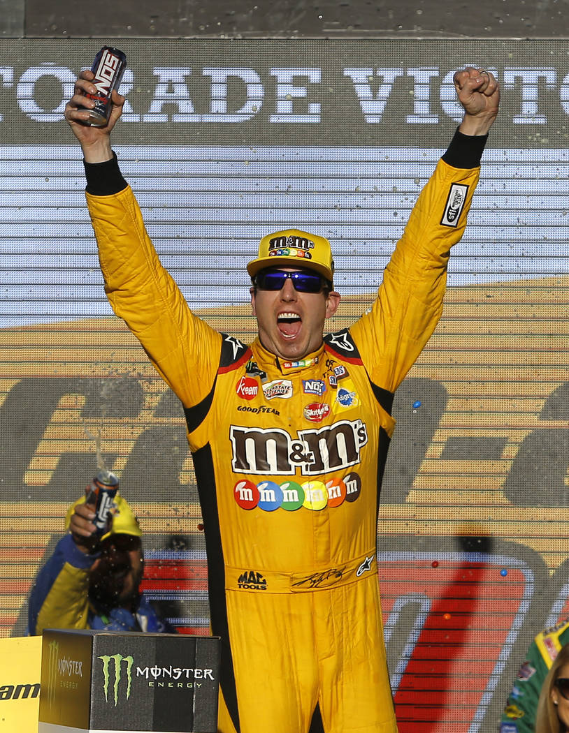 Kyle Busch celebrates after winning a NASCAR Cup Series auto race on Sunday, Nov. 11, 2018, in Avondale, Ariz. (AP Photo/Rick Scuteri)